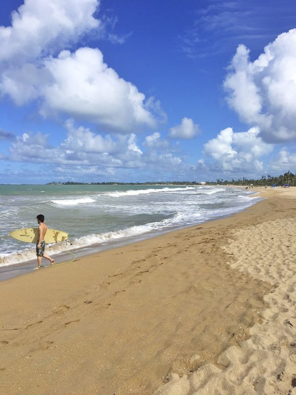 Isla Verde beach in San Juan, Puerto Rico. After Hurricane Maria, parts of the Puerto Rican capital are back in business. Tourism is down but the scene can be lively. (Paola Singer via The New York Times)