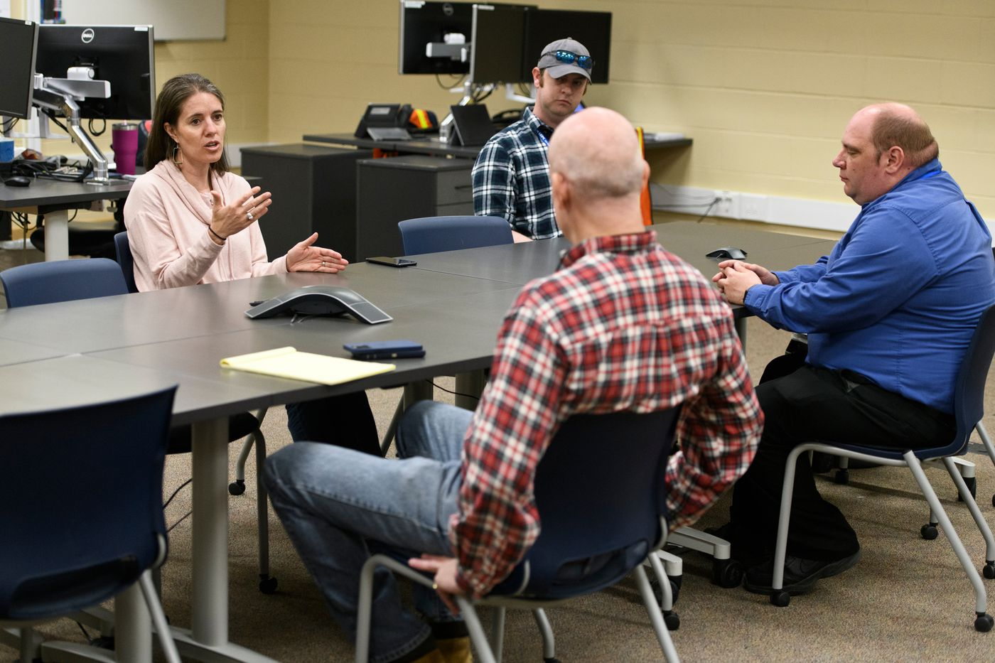 Alaska Chief Medical Officer Anne Zink, left, speaks with Bud Sexton, center, and Dan Nelson, right, at the Kenai Peninsula Borough's Emergency Response Center in Soldotna. (Marc Lester / ADN)
