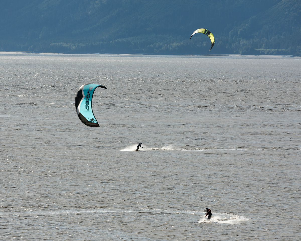 Wind surfers enjoy a sunny day along Turnagain Arm on Tuesday, Aug. 15, 2017. (Loren Holmes / ADN archive)