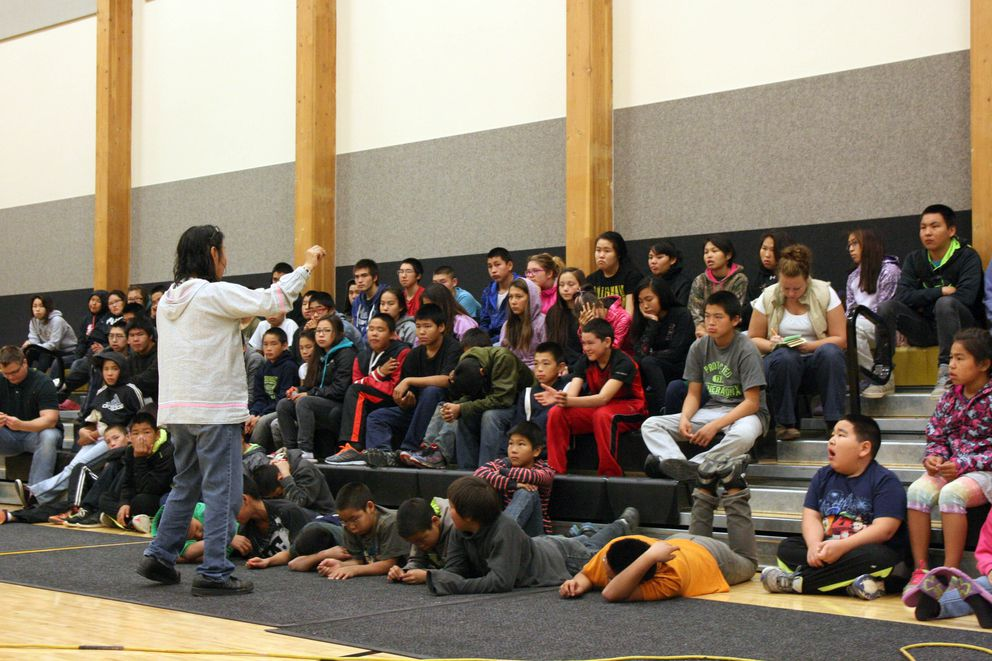 Rose Domnick of Yukon-Kuskokwim Health Corp.'s Calricaraq program for healthy living speaks to middle and high schoolers in Quinhagak on Sept. 15, 2016. (Lisa Demer / Alaska Dispatch News)