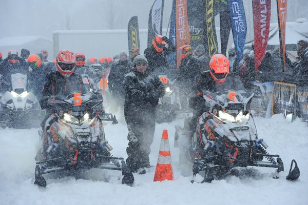 Iron Dog pro class team #5, Zack Weisz, left, and Brett Lapham prepare to leave Deshka Landing during the Iron Dog snowmobile race in Willow during a snowstorm on Sunday, Feb. 17, 2019. Twenty-four two-person teams will travel across 2,000 mile of Alaska wilderness on their way to Nome and a Fairbanks finish. (Bill Roth / ADN)