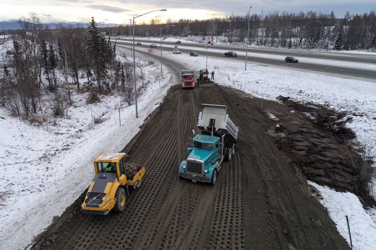 Workers repair damage to the International Airport Road off-ramp at Minnesota Drive on Saturday. State officials say the northbound and southbound Minnesota off-ramps at International are now open. (Courtesy Ryan Marlow / Alaska Aerial Media)