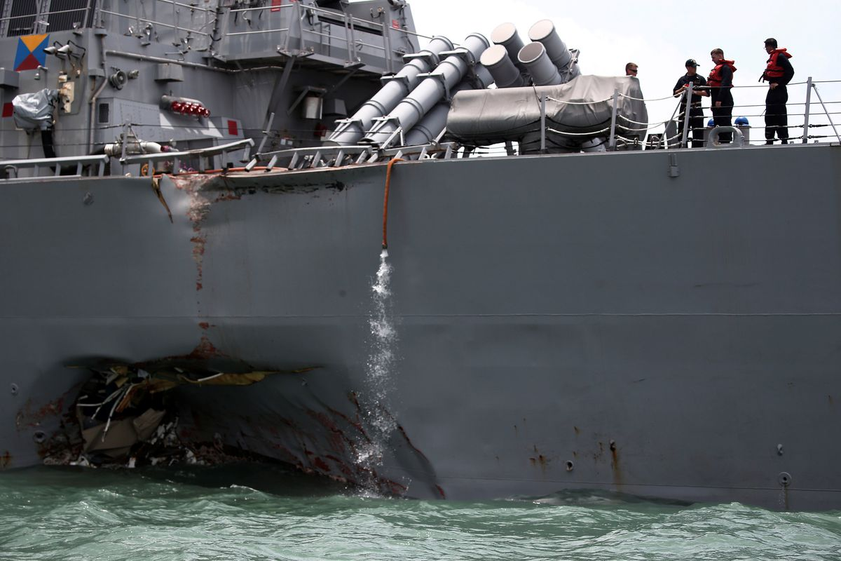 The U.S. Navy guided-missile destroyer USS John S. McCain is seen after a collision, in Singapore waters August 21, 2017.(Ahmad Masood / Reuters file)