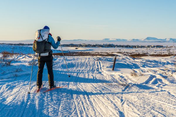 Robin Beebee overlooks Kotzebue at the end of a six-day, 200-plus mile ski trip. By the end of the trek, Bob Gillis and Seth Adams found their strength had begun to wane, whereas Beebee seemed to become stronger. (Seth Adams)