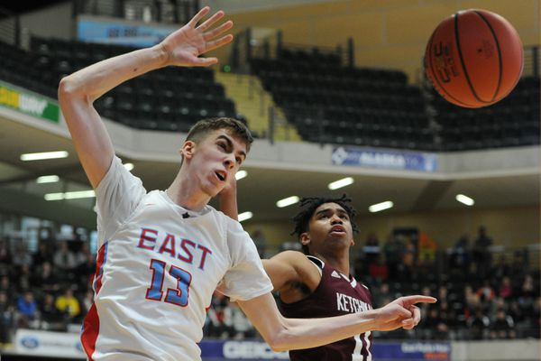 East High Andrew Graves 6'11and Ketchikan Chris Lee 5'11 battle for a rebound during the Kings' 60-58 upset victory over the Thunderbirds during the Boys 4A state basketball championships at the Alaska Airlines Center on Thursday, March 20, 2019. (Bill Roth / ADN)