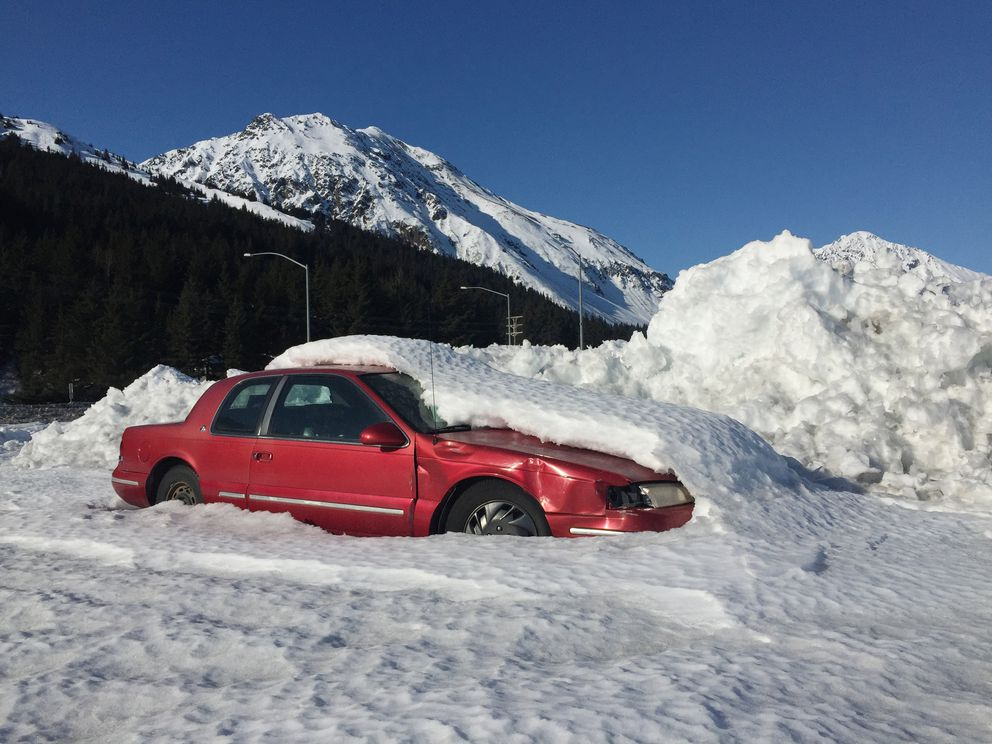 A car waits out winter in public parking near the small boat harboron March 11, 2017, in Seward. (Erik Hill / Alaska Dispatch News)