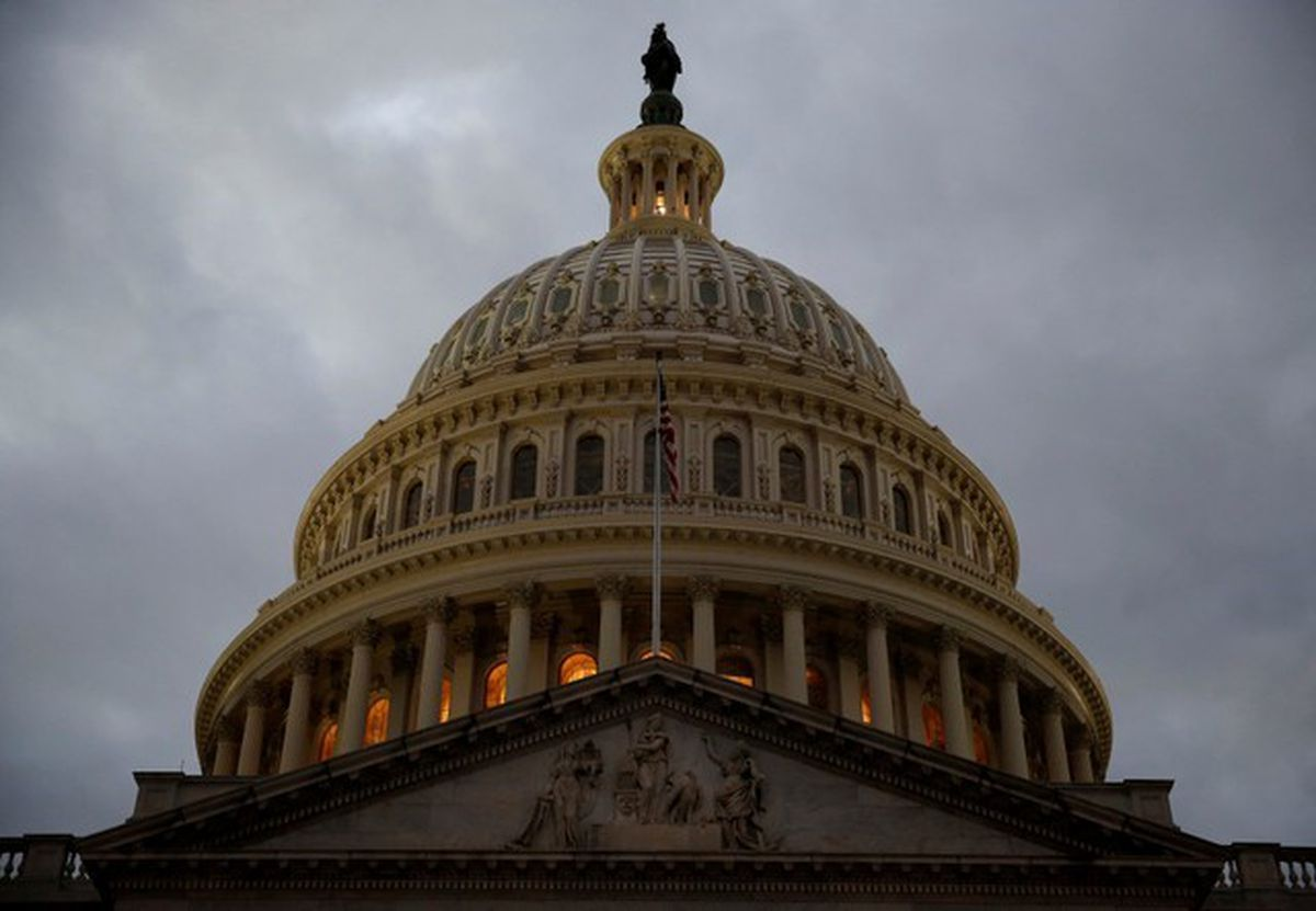 The U.S. Capitol building is lit at dusk. REUTERS/Joshua Roberts/File