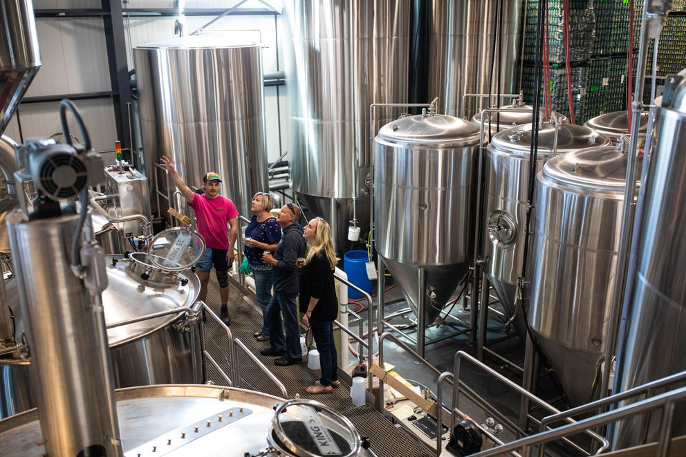 King Street Brewing Company senior brewer Maxwell Crutch, left, gives Traci Hershberger, Gary Hershberger, and Valerie Eubanks a tour of King Street's new facility on Tuesday, June 26, 2018. The three were on a brewery tour operated by Big Swig Tours. (Loren Holmes / ADN)