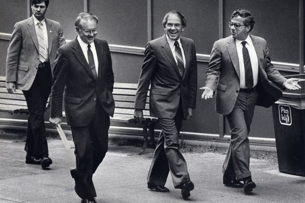 Governor Bill Sheffield grins as he walks back to the Capitol building in Juneau flanked by his attorneys John Conway and Philip Lacovara in 1985. (MICHAEL PENN / Anchorage Daily News) references impeachment debate, Senate vote not to impeach
