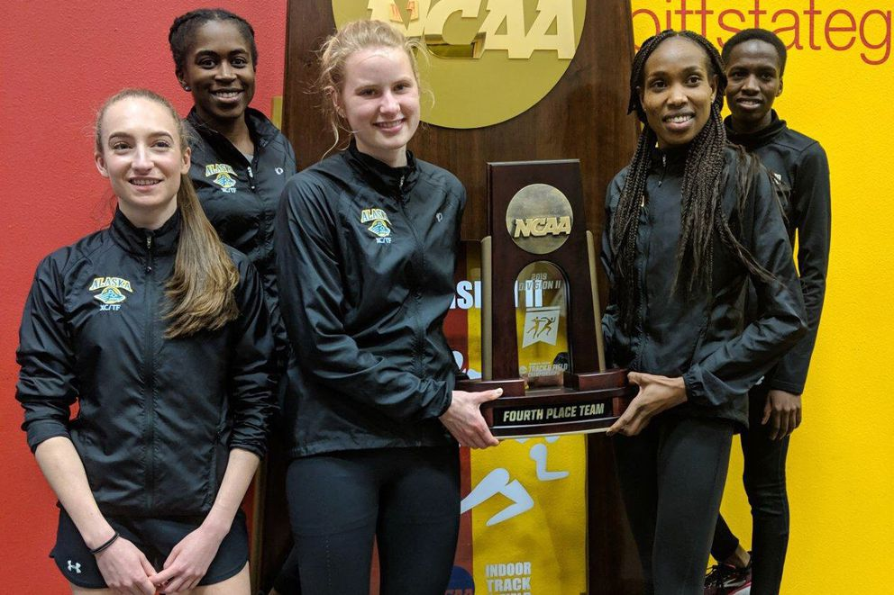 From left, Dani McCormick, Vanessa Aniteye, Ruth Cvancara, Caroline Kurgat and Nancy Jeptoo hold their fourth-place team trophy at the end of the 2019 NCAA Division II indoor track and field championships. (Photo by Ray Shadowens via UAA Athletics)