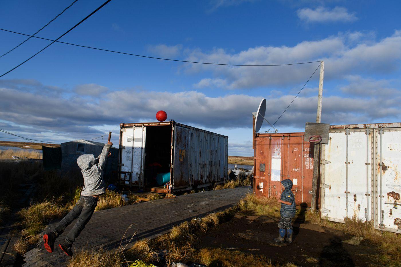 Children shoot hoops in Newtok. (Marc Lester / ADN)