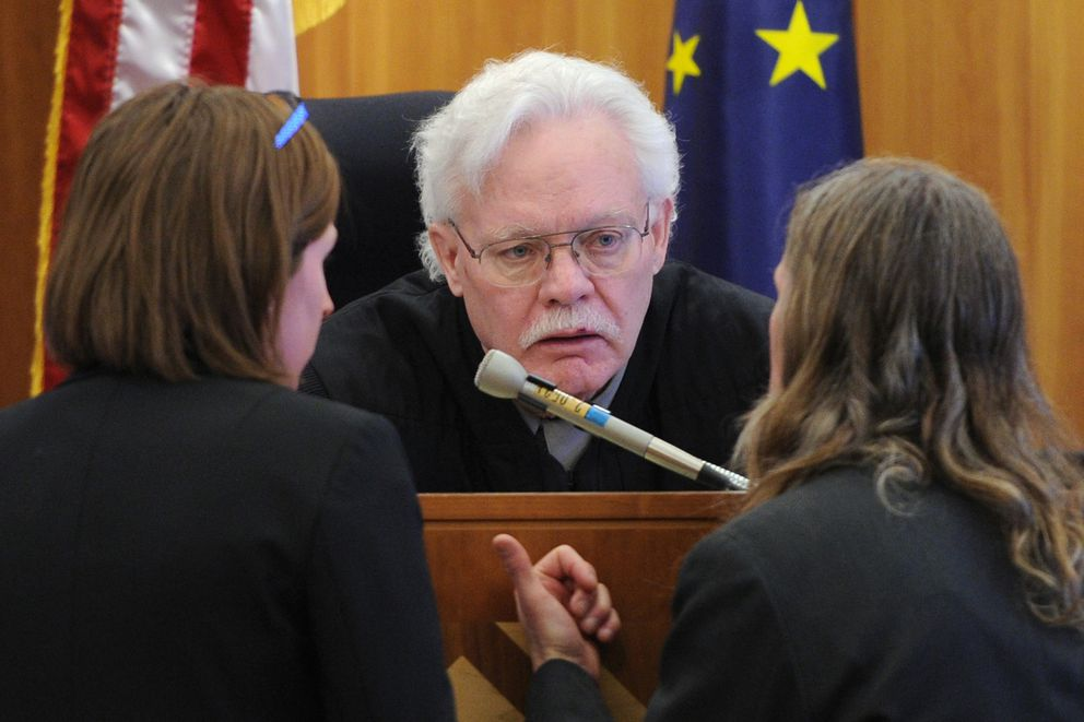 Defense attorney Emily Cooper, left, and prosecutor James Fayette, right, approach the bench of Superior Court Judge Michael Wolverton during the Thomas Skeek murder trial on Tuesday. (Bill Roth / ADN)