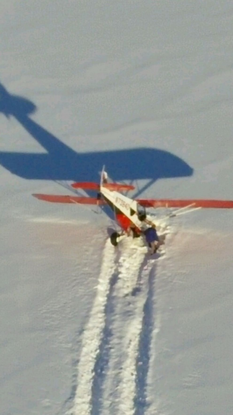 """Robbins' plane after it """"nosed-over"""" in the snow, when landing on a frozen lakeSunday. (U.S. Coast Guard Air Station Kodiak photo)"""