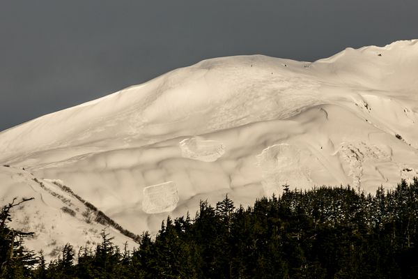 FILE -- Three avalanche chutes are seen on Tincan Mountain's south face, photographed from along the Seward Highway in Turnagain Pass. The avalanches were remotely trigged on Feb.17, 2015, the day after a storm left 2 feet of snow in the upper elevations of Turnagain Pass.