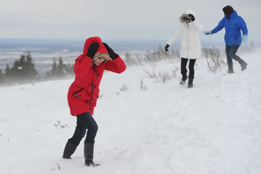 From left, Hui Yu Lin, Jenny Hsu, and Shuping Chang experienced spindrift during gusty winds at the Glen Alps Trailhead and Viewpoint in the Chugach State Park on Sunday. (Bill Roth / ADN)