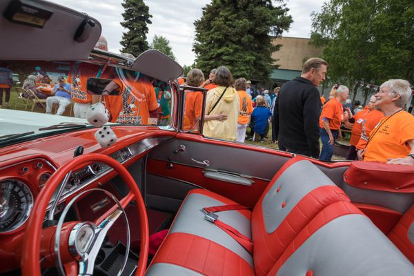 Members of the Anchorage High School class of 1959 gather around a classic car Saturday, June 22, 2019 in Anchorage. For many years Anchorage had only one high school. (Loren Holmes / ADN)