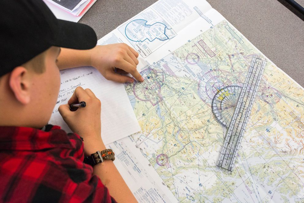 South High freshman Grayson Davey plots a flight path as part of an exercise with the school's Unmanned Aerial Systems pilot program on Thursday, May 20, 2016. The drone pilot training program will be offered as an elective for credit next year, the first for high school students in Alaska. (Loren Holmes / Alaska Dispatch News)