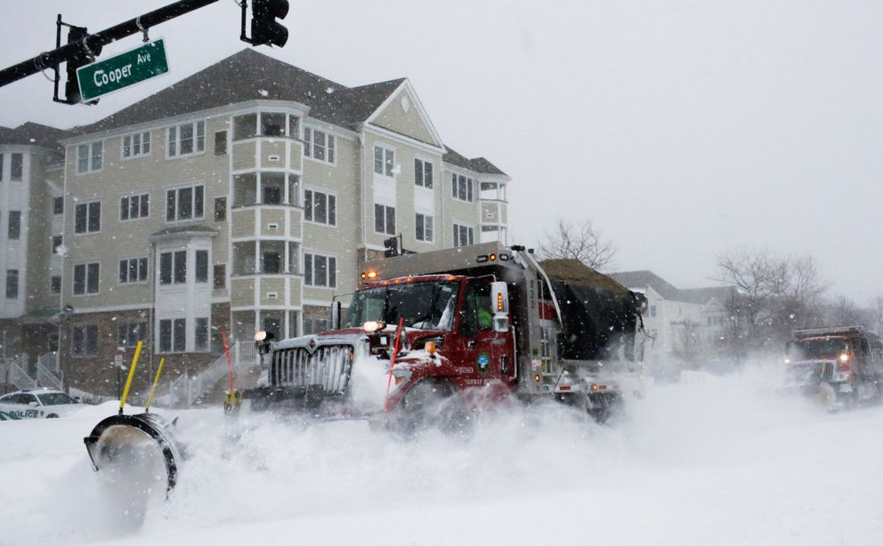 Trucks clearsnow along at shore in Sea Bright, New Jersey. REUTERS/Eduardo Munoz