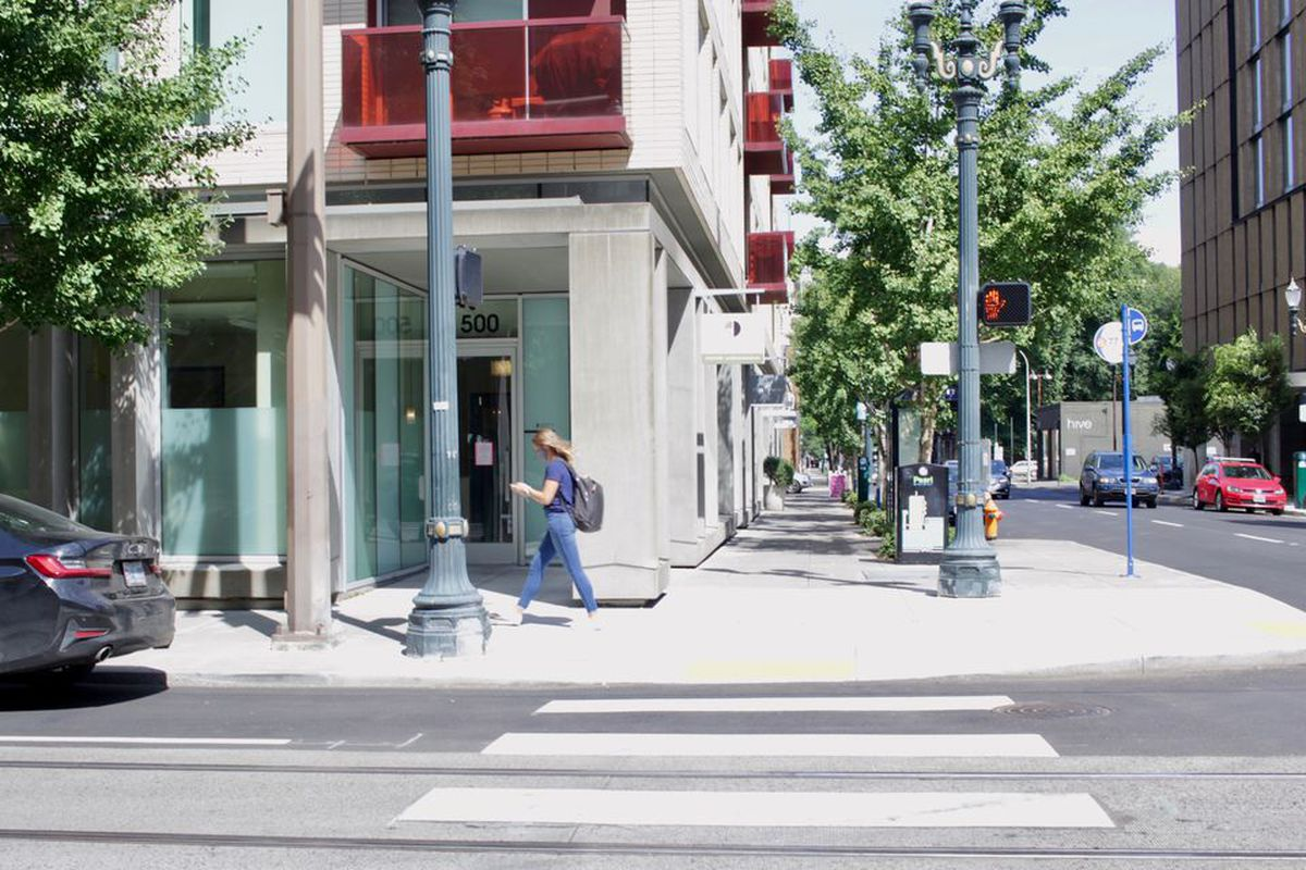 The tony Pearl District neighborhood where protesters rallied in front of Mayor Ted Wheeler's condominium shows is nearly devoid of any evidence a demonstration took place there save for graffiti on two crosswalks. (Eder Campuzano | The Oregonian)