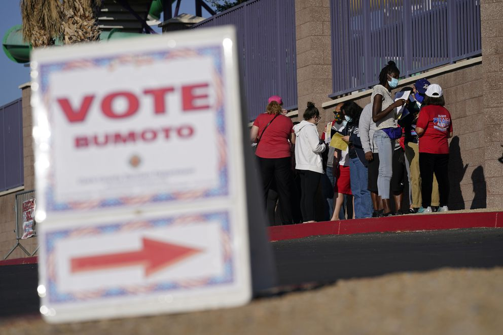 People wait in line to vote at a polling place on Election Day, Tuesday, Nov. 3, 2020, in Las Vegas. (AP Photo/John Locher)