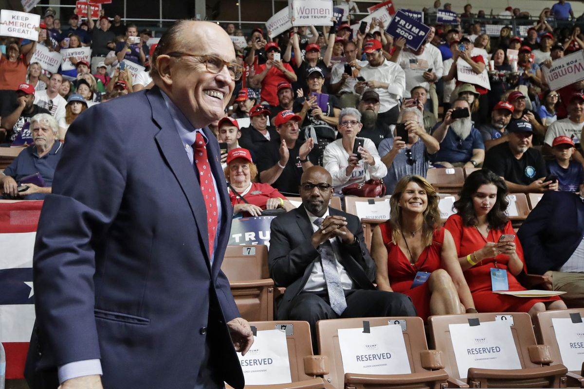 FILE - In this Aug. 15, 2019, file photo, former New York City Mayor Rudy Giuliani smiles as he arrives to President Donald Trump's campaign rally in Manchester, N.H. (AP Photo/Elise Amendola, File)