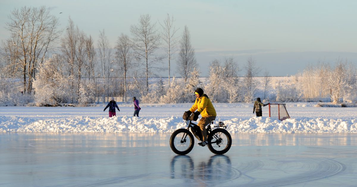 A sunny afternoon draws outdoors enthusiasts to the ice on Dec. 14, at Westchester Lagoon. (Erik Hill / Alaska Dispatch News)