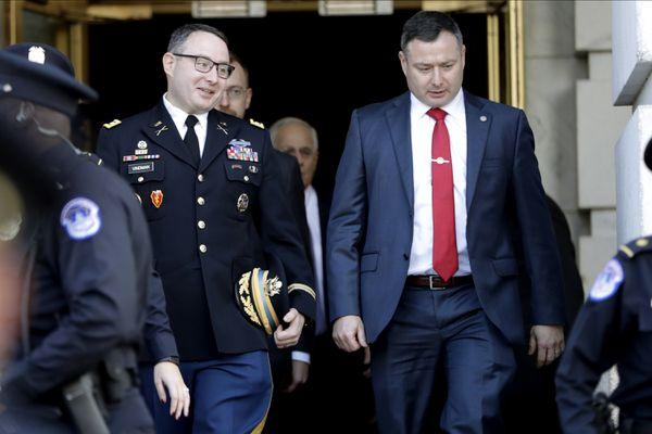 FILE - In this Nov. 19, 2019, file photo then National Security Council aide Lt. Col. Alexander Vindman, left, walks with his twin brother, Army Lt. Col. Yevgeny Vindman, after testifying before the House Intelligence Committee on Capitol Hill in Washington, during a public impeachment hearing of President Donald Trump's efforts to tie U.S. aid for Ukraine to investigations of his political opponents. The Army confirms that both Lt. Cols. Vindman have been reassigned to the Department of the Army,(AP Photo/Julio Cortez, File)