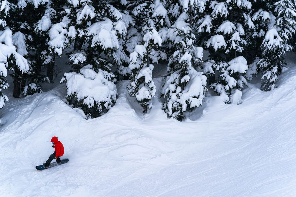 A snowboarder takes advantage of ample snow at Alyeska Resort on opening day Friday. (Loren Holmes / ADN)