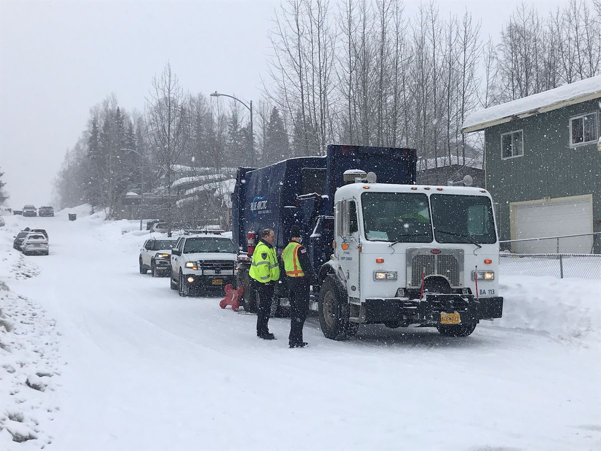 A man died after being struck by a garbage truck in East Anchorage early on Thursday, March 25, 2021, police said. (Tess Williams / ADN)