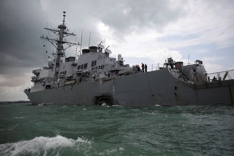 The U.S. Navy guided-missile destroyer USS John S. McCain is seen after a collision in Singapore waters August 21, 2017. REUTERS/Ahmad Masood