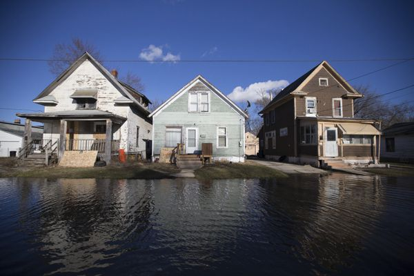 Floodwaters lap close to the front yards of homes on Friday, March 15, 2019, in Freeport, Ill. Rising waters along the Pecatonica and Rock rivers have flooded homes in northern Illinois. (Scott P Yates/Rockford Register Star via AP)