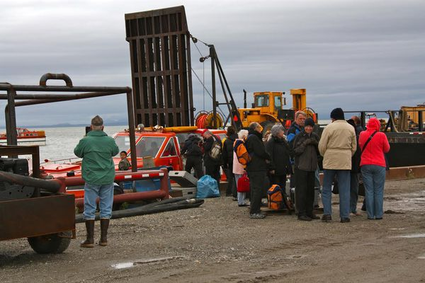 Passengers from a German cruise ship arrive unexpectedly in Kotzebue in 2012, after weather forced a detour from Nome. The episode forced coastal communities to begin thinking about how to respond to a cruise ship emergency as more ships -- including a massive luxury liner set to sail the Northwest Passage in 2016 -- ply Arctic waters.
