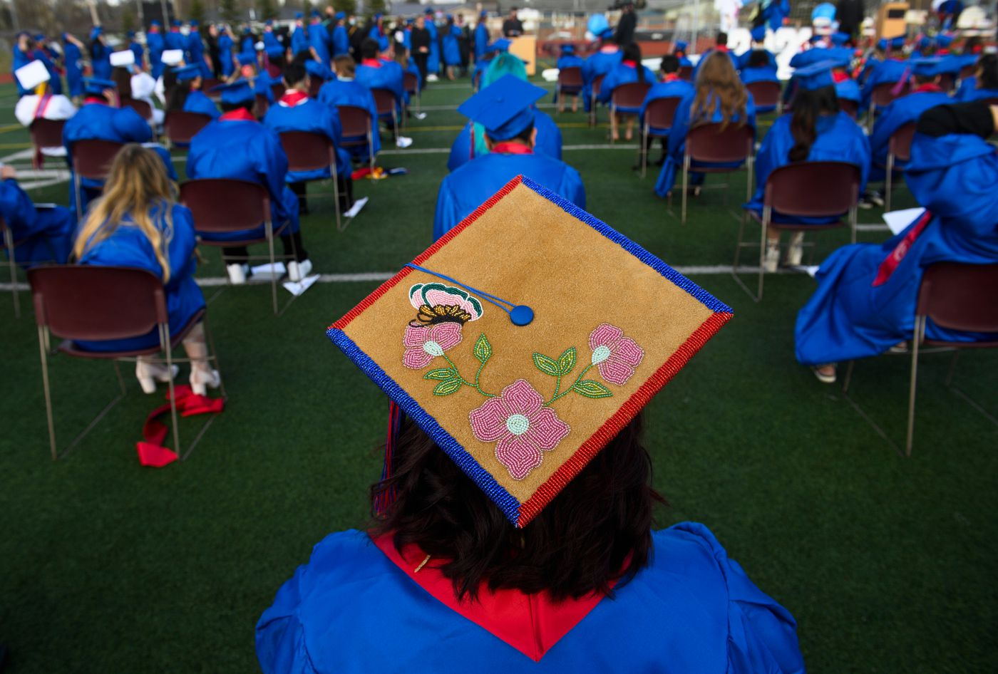 """Ermelina Gonzalez said her graduation cap was beaded by her mother. """"I'm really proud to be Athabaskan,"""" she said after her East High School graduation on May 11, 2021. (Marc Lester / ADN)"""