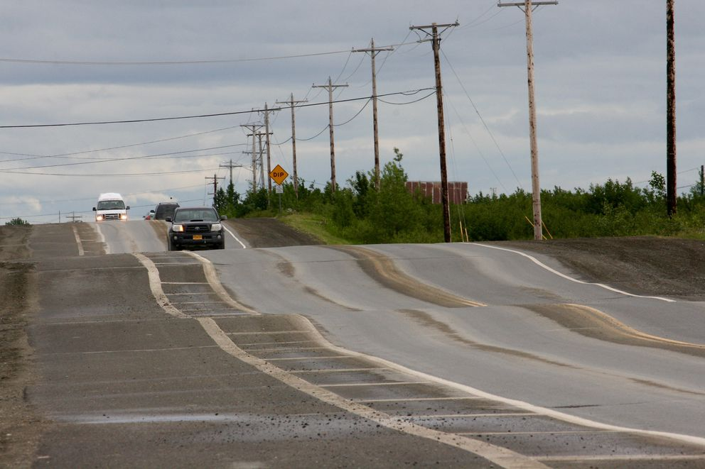 Chief Eddie Hoffman Highway, seen on June 28, 2017, is the main thoroughfare in Bethel, and one of few paved roads. It has become a roller coaster of a ride over the past couple of years. The state Department of Transportation is studying whether heaves from the thaw-freeze of permafrost is a factor. (Lisa Demer / Alaska Dispatch News)