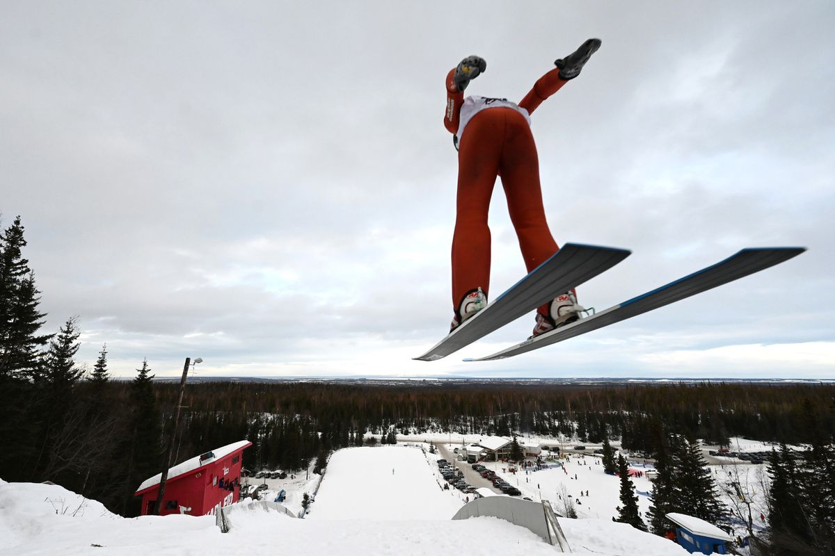 Ronen Woods of Team AK launches off the 65-meter jump Sunday at the Karl Eid Ski Jumping Complex at Hilltop Ski Area. (Bill Roth / ADN)