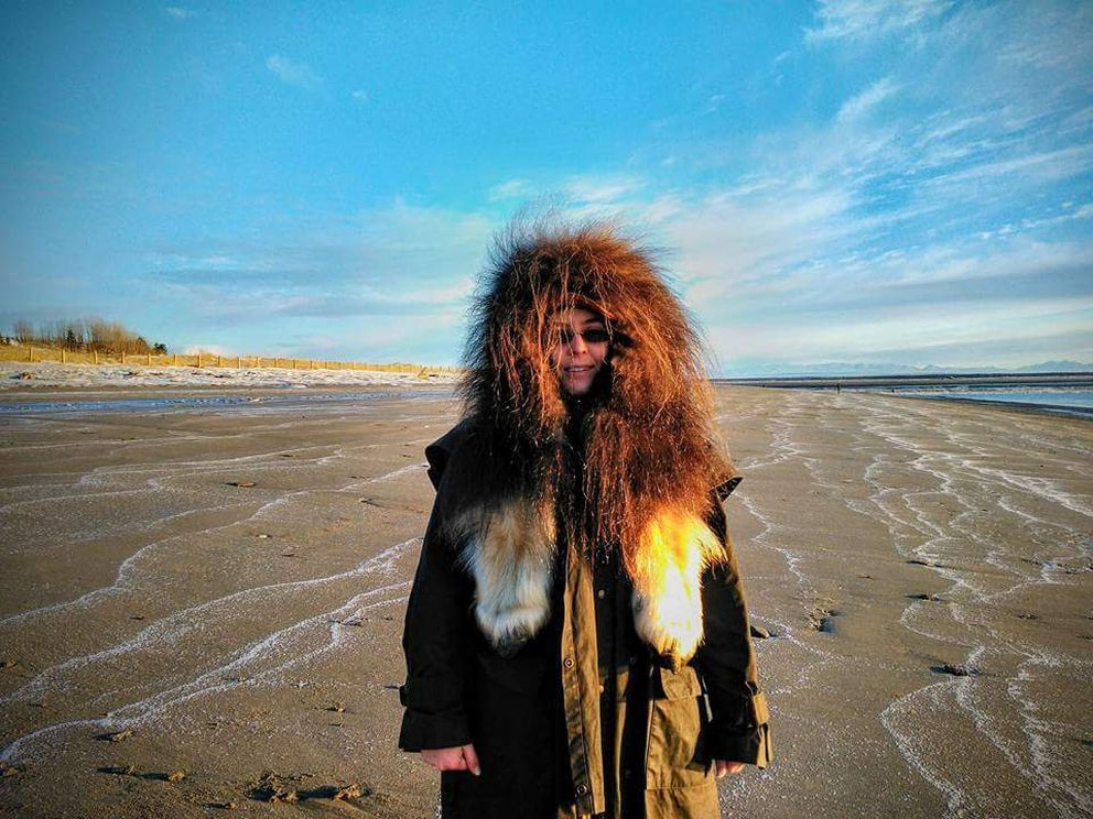 Amanda Alaniz shows a musk ox hat she made. She's standing on the Kenai beach. (Photo provided by Amanda Alaniz)
