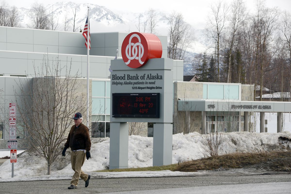 A person walks by the Blood Bank of Alaska, Monday, April 13, 2020. (Anne Raup / ADN)