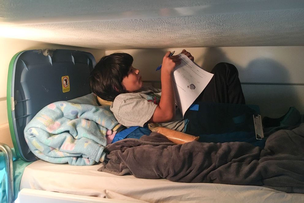 Fourth-grader Lucas Mayfield does homeschool work in his family's camper during a trip to Homer. (Courtesy Jeff Mayfield)