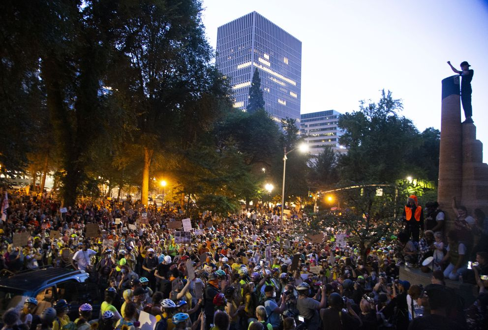 Thousands of people showed up in downtown Portland for day 54 of protests there Monday, July 20, 2020. A potential constitutional crisis is looming over the actions of federal officers at protests in Portland that have been hailed by President Donald Trump but were done without local consent. (Beth Nakamura/The Oregonian via AP)