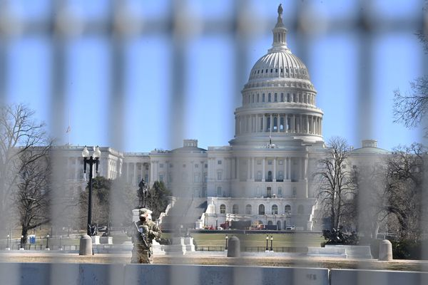 A member of the National Guard watches over the Capitol on Feb. 25, 2021. MUST CREDIT: Washington Post photo by Matt McClain