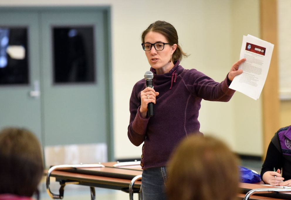 Dr. Anne Zink, chief medical officer for the state of Alaska, speaks to people during a legislative town hall meeting at Chugiak High School on Saturday, Feb. 29, 2020. (Matt Tunseth / ADN)
