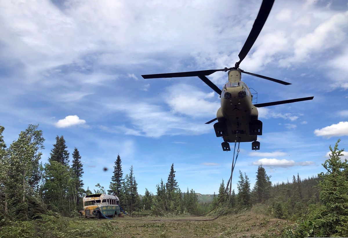 Alaska Army National Guard soldiers use a CH-47 Chinook helicopter to removed an abandoned bus, popularized by the book and movie