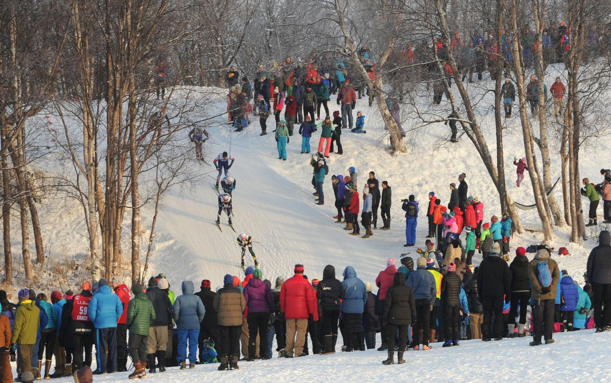 Spectators line the course to watch the men's freestyle sprint final at the U.S. Cross Country Championships at Kincaid Park earlier this month. (Bill Roth / ADN)