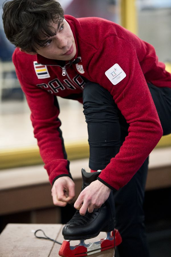 Keegan Messing laces his skates before performing an exhibition at his send-off party. (Marc Lester / ADN)