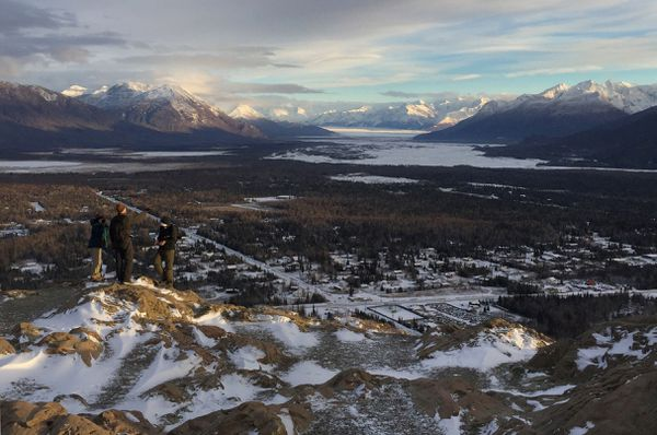 Hikers brave a stiff breeze at the top of Bodenburg Butte. The 360-degree view includes the Talkeetna Mountains, the Knik Glacier and River and the Chugach Mountains. (Anne Raup / ADN archive)