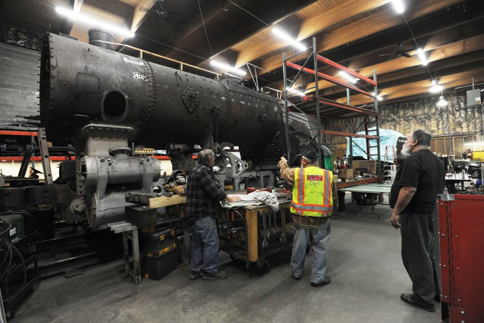 Engine 557 begins to take shape again following replacement of the boiler firebox this past summer as visitors take a look on Wednesday. (Erik Hill / Alaska Dispatch News)