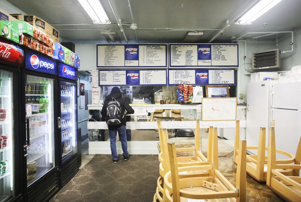 Vaughn Johnson places a to-go order at Scottie's Sub Shop on W. Fifth Avenue in downtown Anchorage on Tuesday, Dec. 29, 2020. (Emily Mesner / ADN)