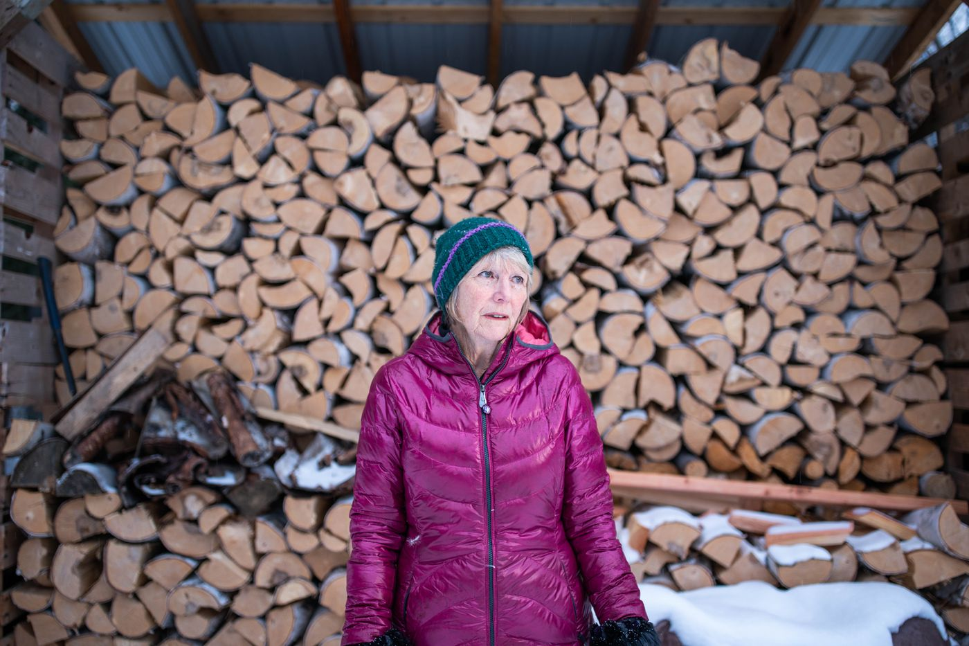 Sue Royston at her home in Fairbanks. She lives in a log cabin, which was her childhood dream. Her daughter and grandson come over often, and before winter each year they help her stock up on firewood. (Loren Holmes/Anchorage Daily News)