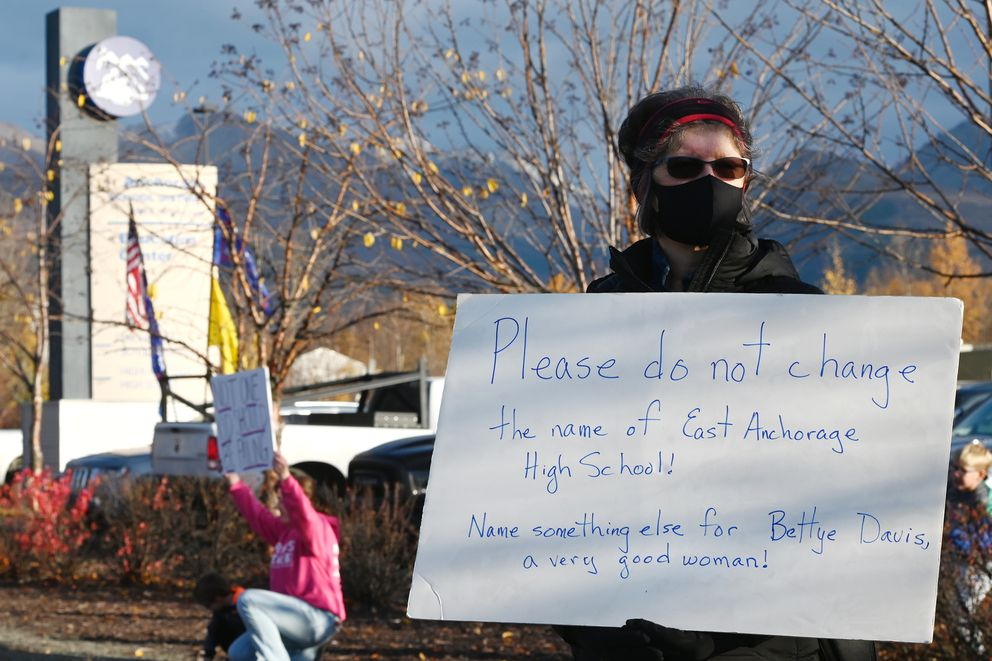 East High School alumna Brenda Bergsrud held a sign outside the Anchorage School Board meeting on Tuesday, Oct. 6, 2020, asking that they do not change the name of East Anchorage High School. Bergsrud said Bettye Davis was a very good woman and would like to see the Education Center named after her. (Bill Roth / ADN)