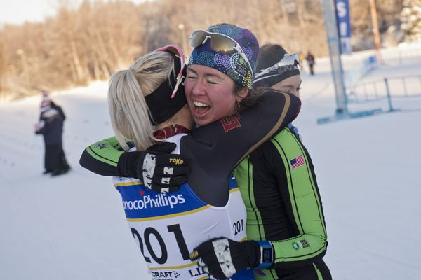 Caitlin Patterson, right, of Craftsbury GRP, is congratulated on her classic sprint title by Jasmi Joensuu, of University of Denver. The final day of the U.S. Cross Country Ski Championships featured men's and women's classic sprint racing on January 8, 2018. (Marc Lester / ADN)